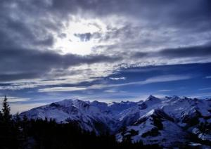 Mountains with a bright blue cloudy sky.